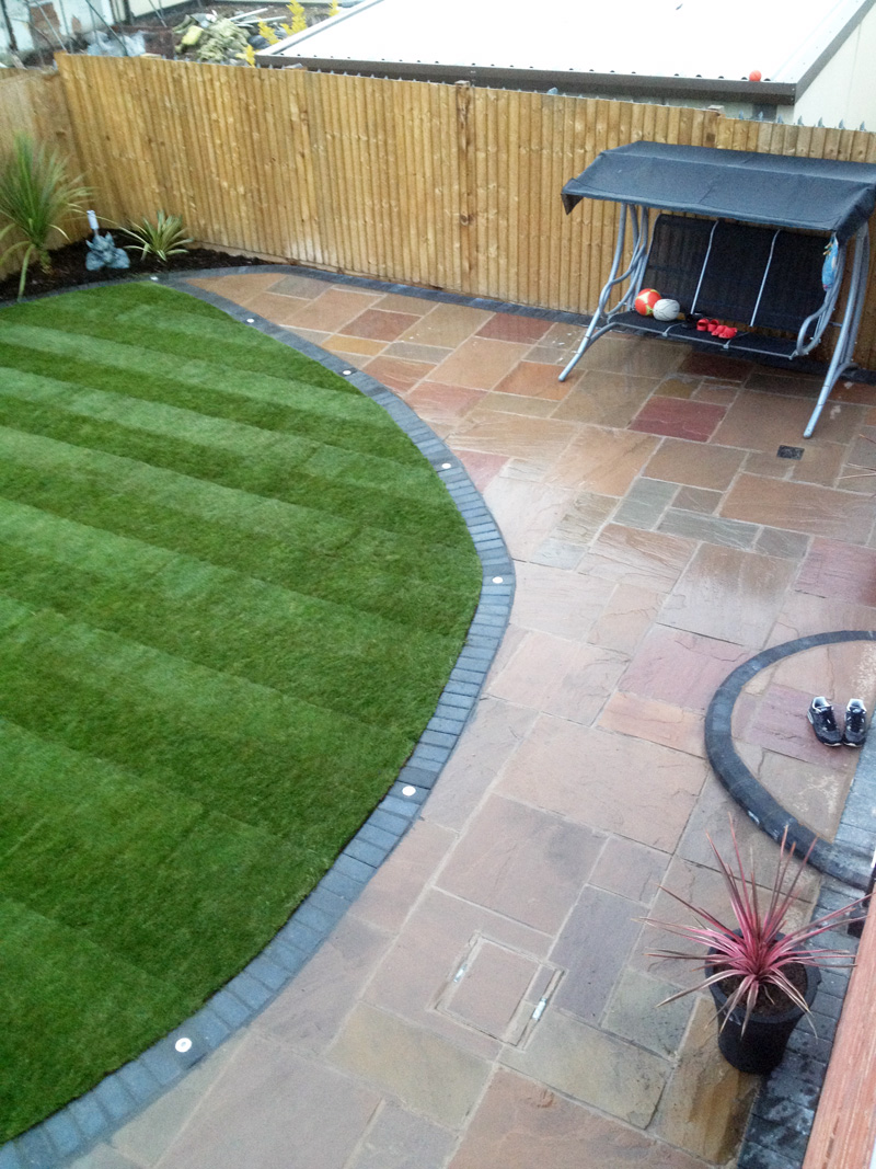 AFTER: Autumn Brown With Charcoal Block Border With Beautiful Newly Laid  Lawn.